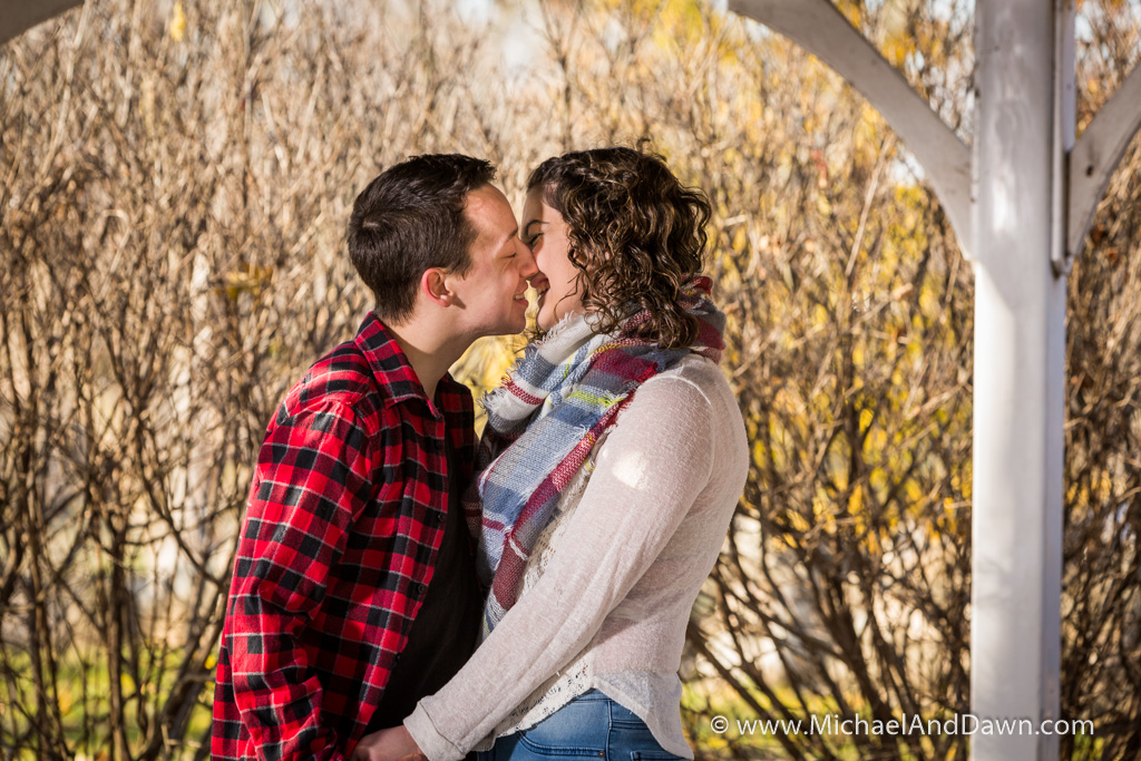 picture of and engagement kiss under the gazebo