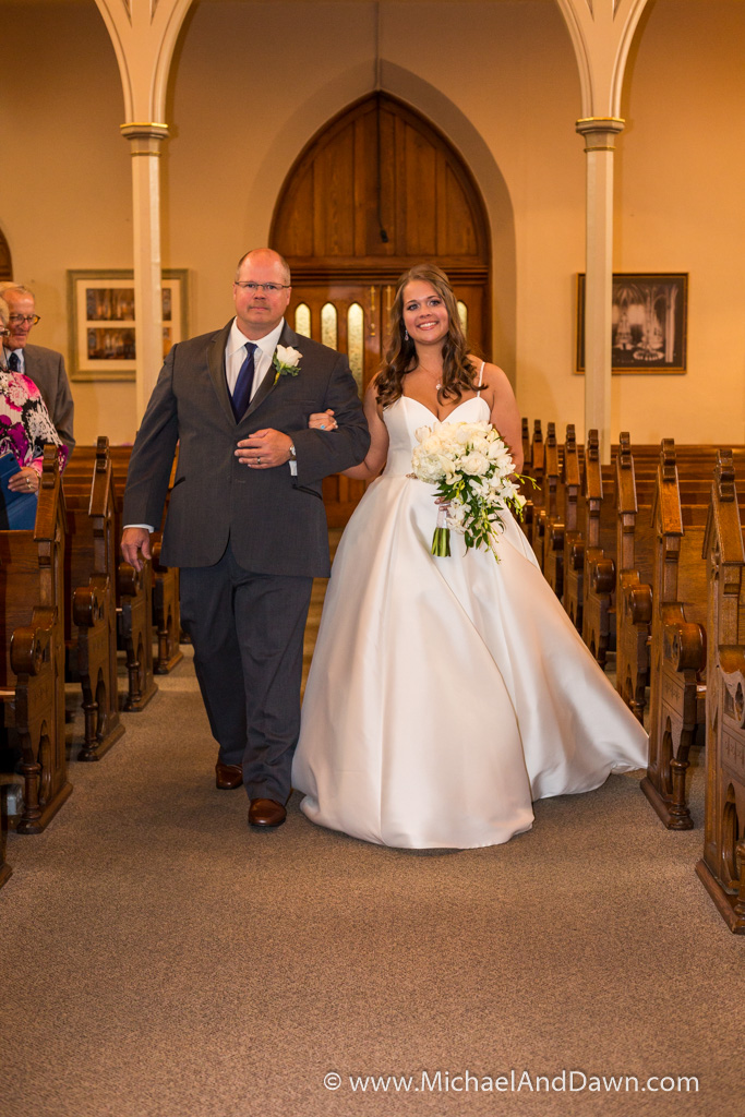 picture of father walking bride down isle