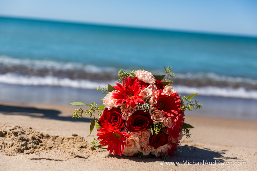 picture of brides bouquet on the beach by the water