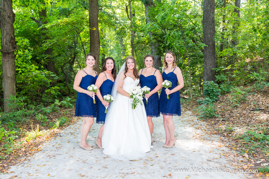 picture of bride iwth bridesmaids on wooded trail