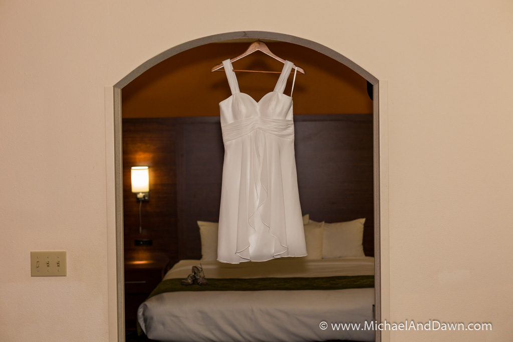 picture of white wedding dress on hanger