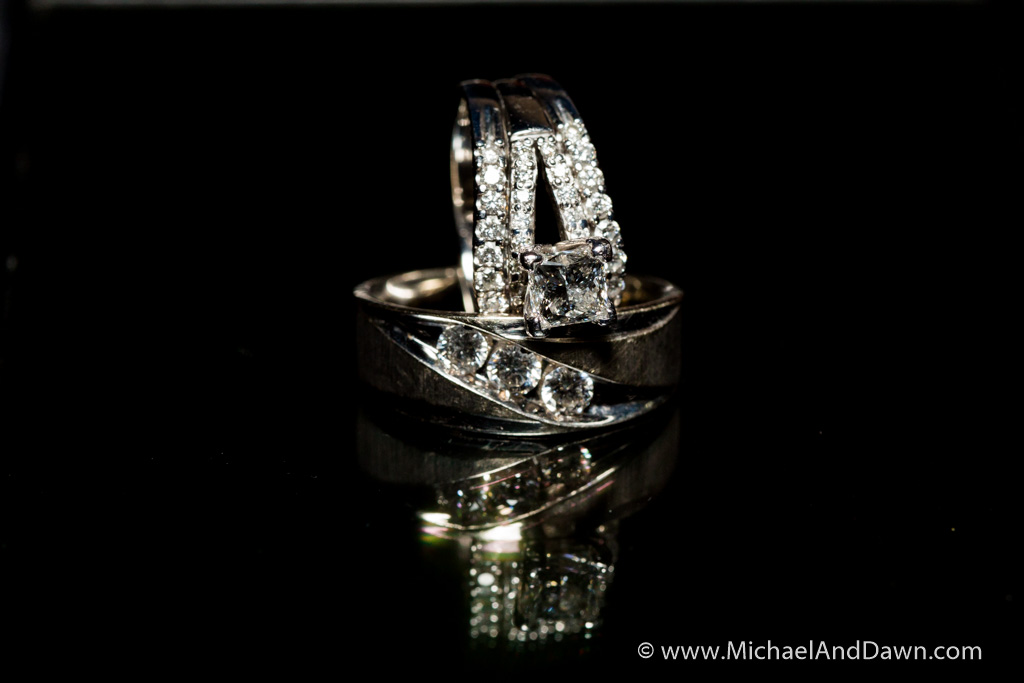 picture of wedding rings for two brides on black