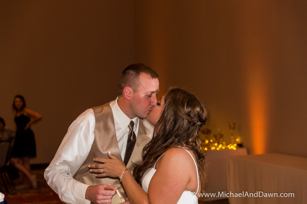 picture of the groom kissing the bride at the reception