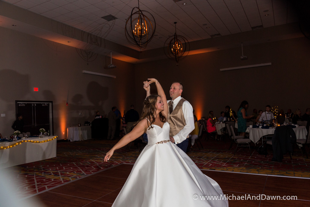 picture of groom twirling bride on dance floor