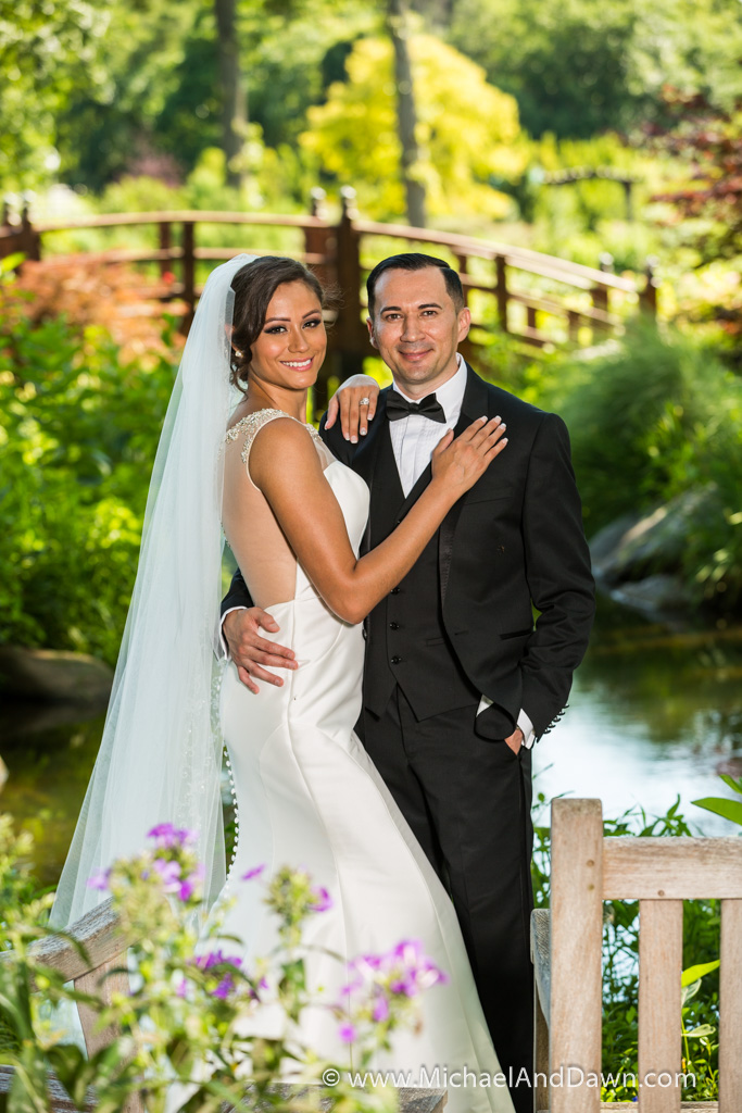 picture of groom and bride with bridge in background