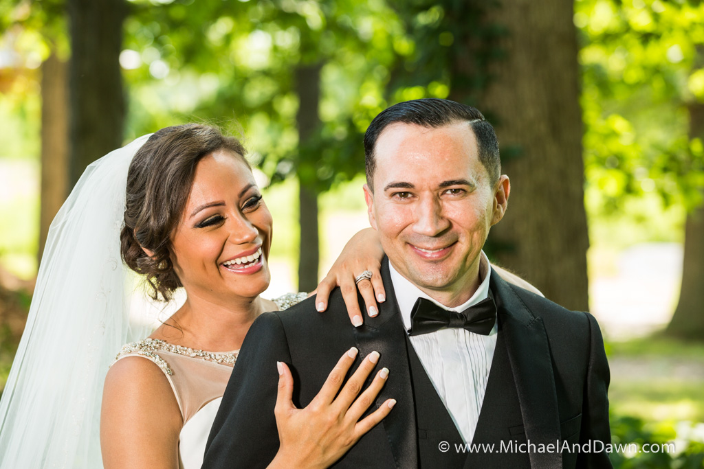 picture of groom with bride smiling at him