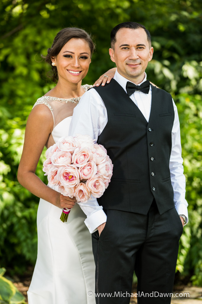 picture of bride and groom with pink flower bouquet