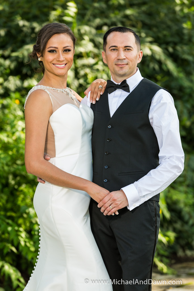 picture of bride and groom standing next to each other