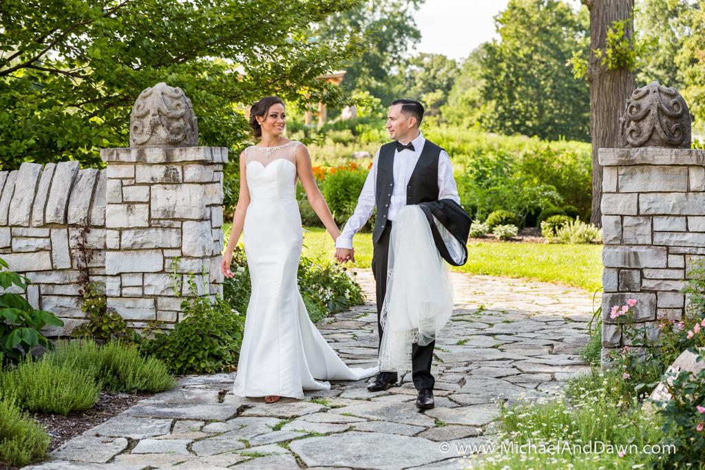 groom and bride walking holding hands